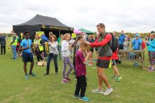 Mr Reeve presents medals to successful child runners.