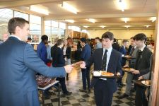 Mr Reeve hands out Crackers at our Christmas Lunch