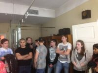 Sombre students listening to tour guide, Schindlers factory, Krakow