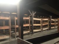 Bunk Beds in a womens hut (Wooden cattle shed)