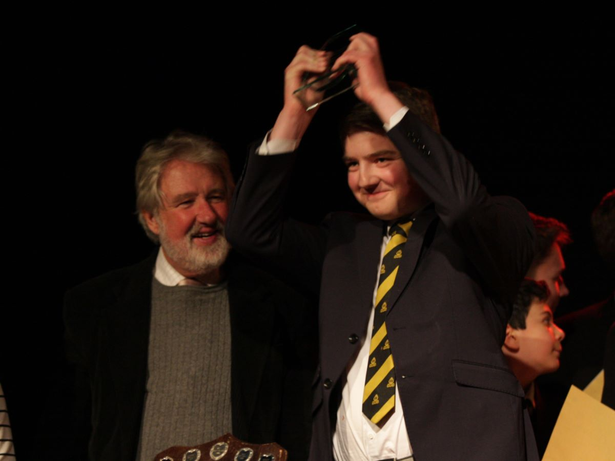 Eli Haines collects the Music Festival House Trophy for Meads House